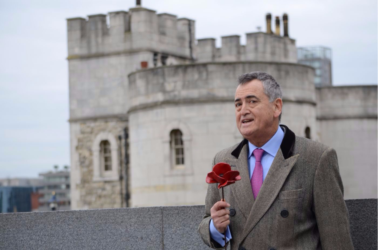 Christopher West holding a poppy at The Tower of London